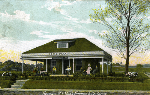 A postcard of the Harmon sales office on the corner of South Riverside Avenue and Benedict Boulevard. The building is now a nail salon.