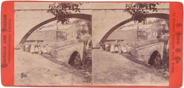 "Stereoview by H. Rofes & Co., circa 1865, showing the Arcade File Works (erroneously called ""Arcade Tile Works"" on the paper label on the back). The company began operation in 1848 in the old mill and a new building next door. The mill power was used by the factory, which stayed in business until the early 1900s. The firm took the name Arcade from the aqueduct arch spanning the valley."