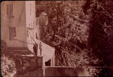 Detail from a stereoview looking southwest down the Kill, over the Arcade File Works mill dam.