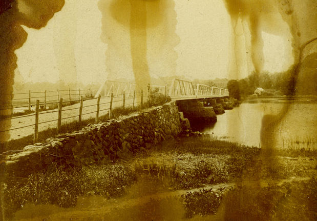 This detail from a rare, badly damaged stereoview shows the Van Cortlandt bridge from the Ossining side. The building on the far side of the Croton River stood at the end of the long causeway, in front of the Van Cortlandt Manor house.