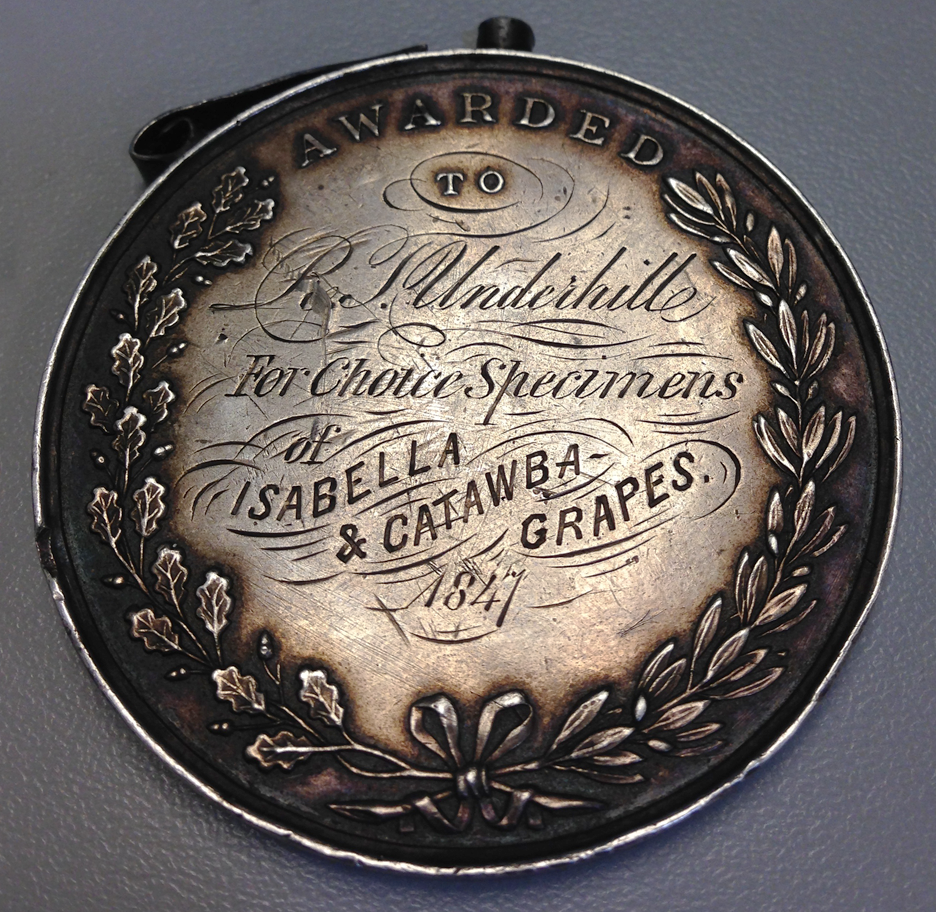 "Back of the silver medal awarded to R.T. Underhill in 1847 ""for choice specimens of Isabella & Catawba grapes.""."