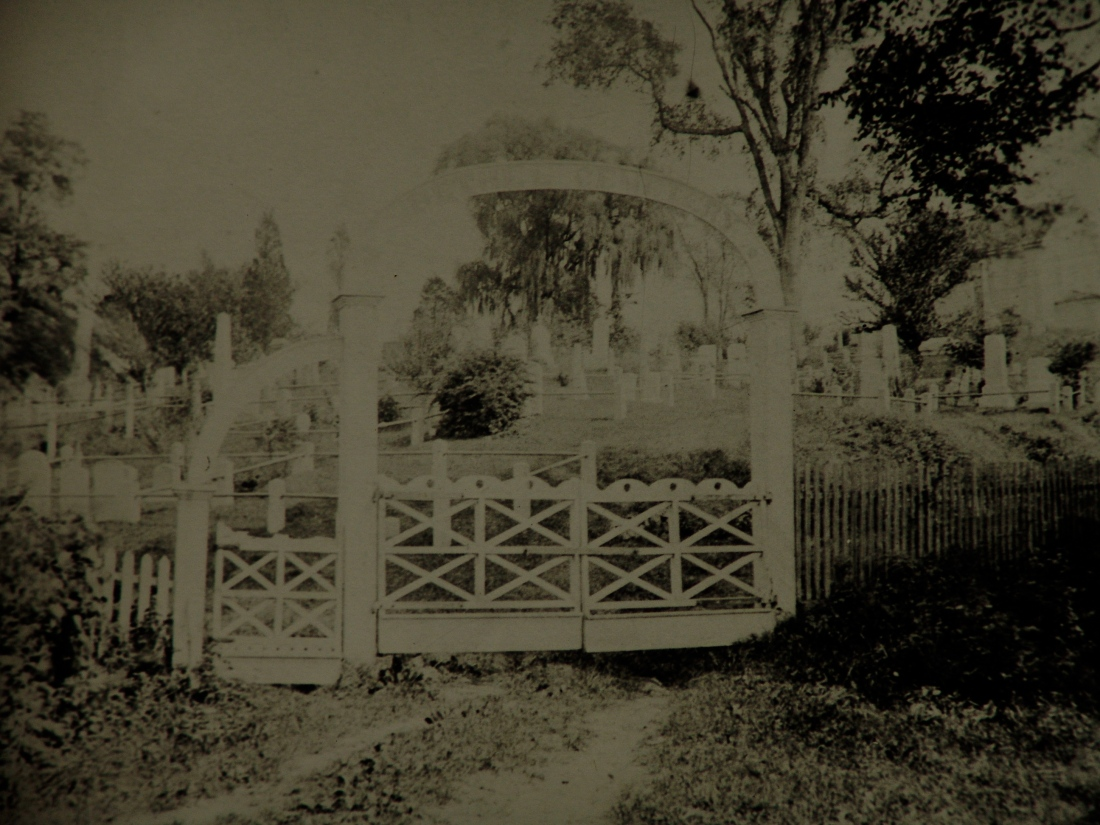 Unretouched image of the entrance gate to Bethel Cemetery.