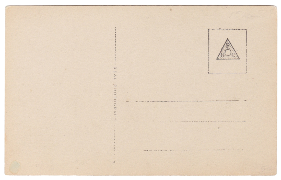 This simple stamp on the back is typical of real photo postcards.
