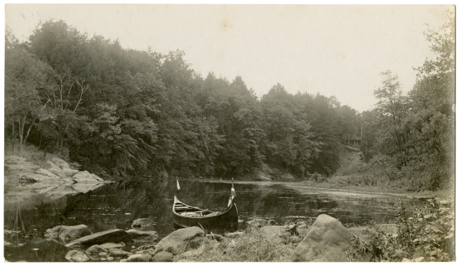 Canoe on the Croton River, south of the Nikko Inn. The Nikko can be seen on the cliff in the upper right. Courtesy of the Westchester County Historical Society.
